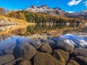 Autumn reflections on lake Silvaplana