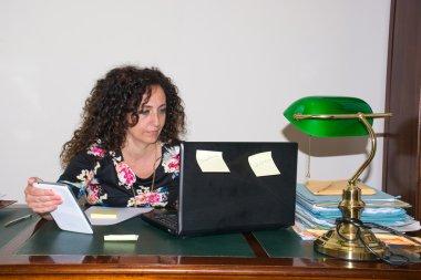 Modern woman, working in her office.