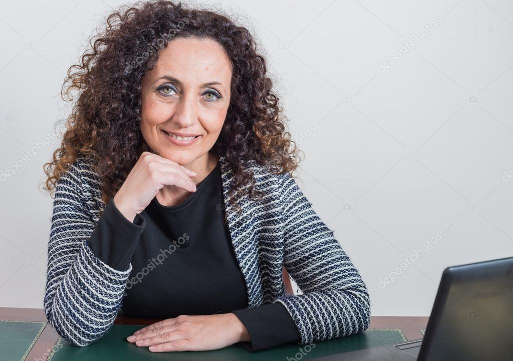 Portrait of mature woman. With curly hair, blacks or dark, green eyes, on  white or clear. — Photo by GCammarata