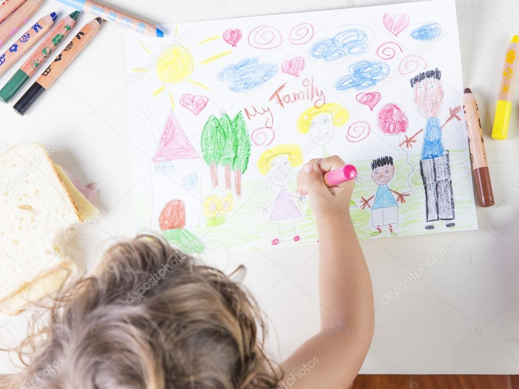 Little girl painting a pink dress of a girl in a kids drawing of