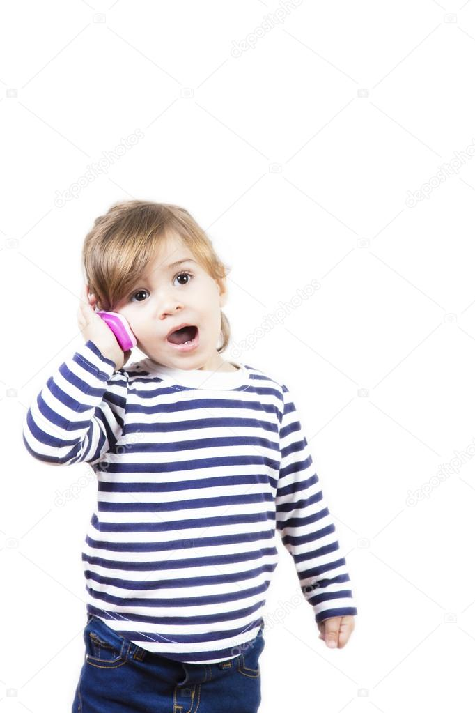 825ede92dd4 Cute little girl talking with a pink phone isolated on white — Stock ...