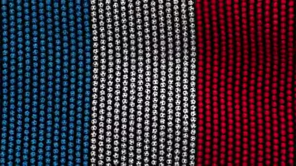 Flag of France, consisting of many balls fluttering in the wind, on a black background.