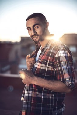 Good looking young arab man in casual clothes in urban environme