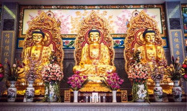 Golden buddha statues in chinese temple