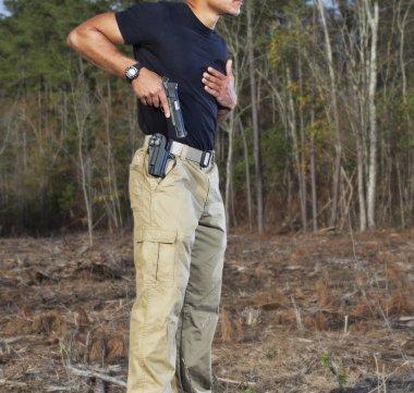 Handgun draw in a forest