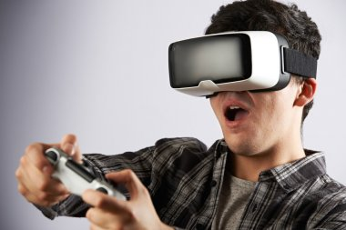 Man Playing Video Game Wearing Virtual Reality Headset