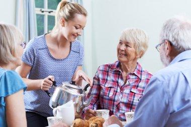 Volunteer Helping At Social Club For Seniors