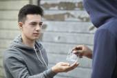 Fotografie Teenage Boy Buying Drugs On The Street From Dealer