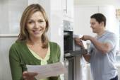 Photo Satisfied Female Customer With Oven Repair Bill