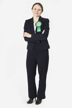 Full Length Portrait Of Female Politician Wearing Green Rosette