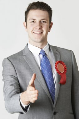Portrait Of Politician Reaching Out To Shake Hands