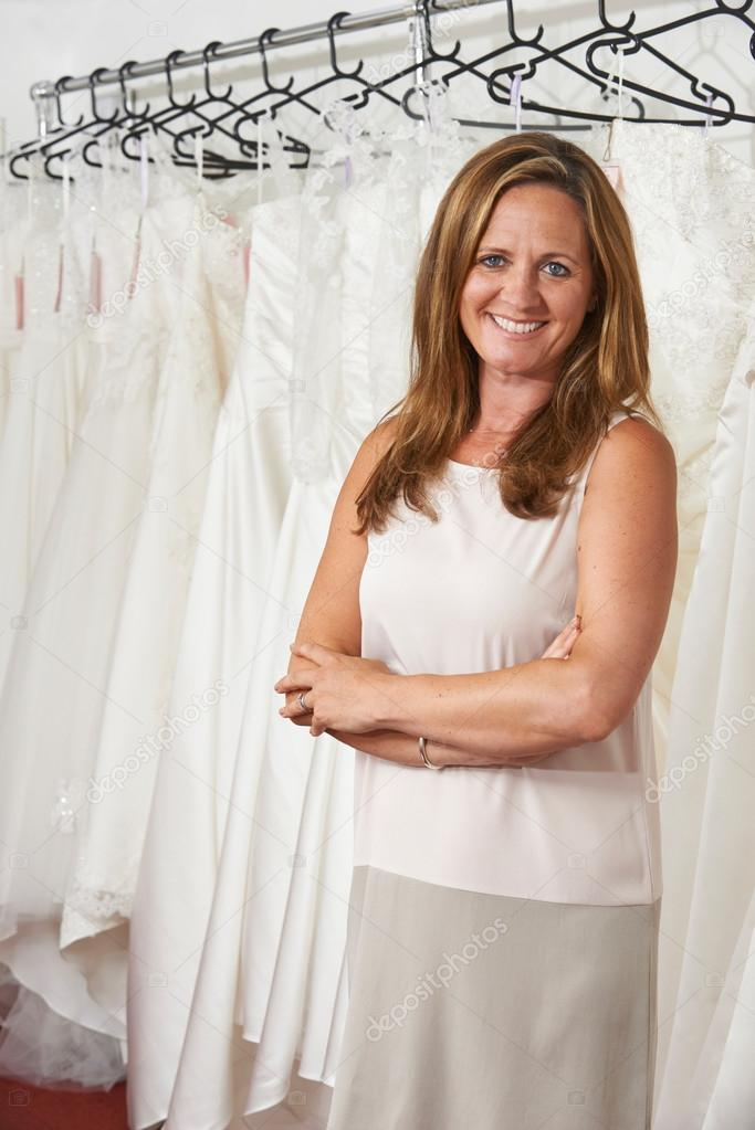 Portrait Of Female Bridal Owner With Wedding Dresses Stock Photo 88321846