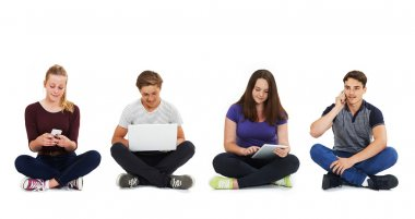 Studio Shot Of Teenagers Using Communication Technology