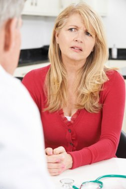 Worried Mature Woman Meeting With Doctor In Surgery