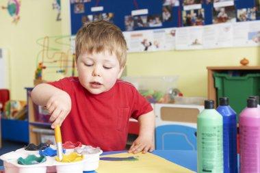 Male Pre School Pupil In Art Lesson