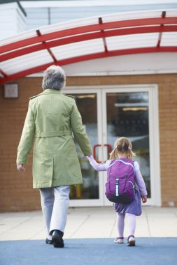Grandmother Taking Granddaughter To School