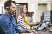 Fotografie Male Customer Services Agent In Call Centre
