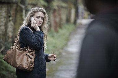 Teenage Girl Feeling Threatened As She Walks Along Path