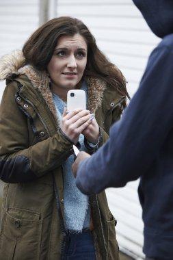 Teenage Girl Being Mugged For Mobile Phone