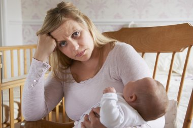 Tired Mother Suffering With Post Natal Depression