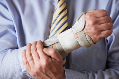 Close Up Of Businessman Suffering With Repetitive Strain Injury