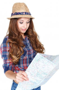 Beautiful young female tourist studying a map and selects a route of travel. isolated on white background stock vector