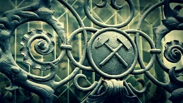 Cinematic shot of iron masonic symbols