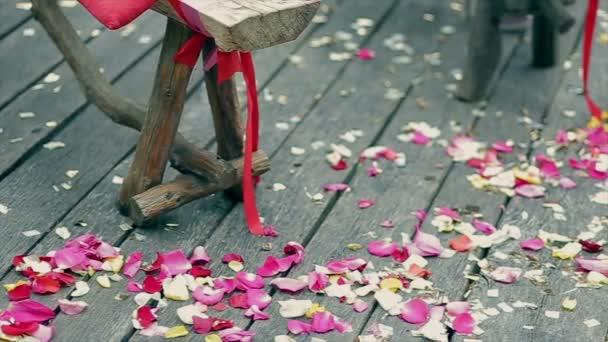 Wedding decoration, colorful petals of roses on wooden boards