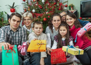 Portrait of happy multigeneration family with Christmas gifts si