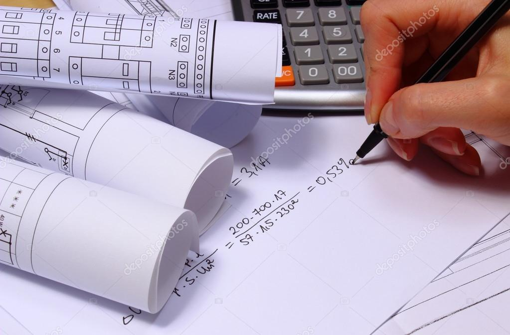 Rolos de diagramas eltricos calculadora e clculos matemticos hand of woman performing mathematical calculations for project rolls of electrical diagrams drawings for the projects engineer jobs foto de ratmaner ccuart Image collections