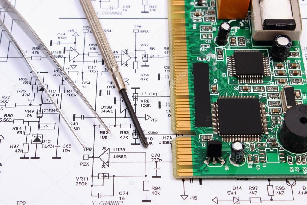 Printed circuit board and precision tools on diagram of electronics ...
