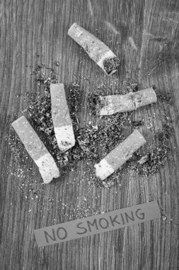 Cigarette butts and ash, healthy lifestyles without cigarettes