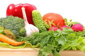 Fresh ripe raw vegetables on wooden cutting board