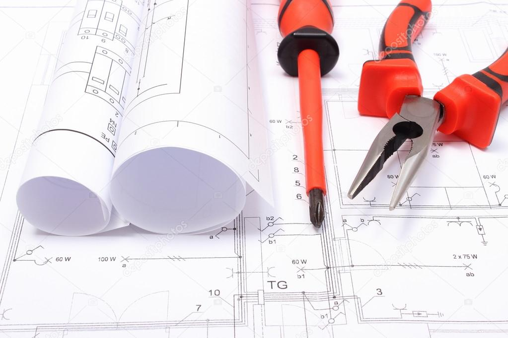 Rolled electrical diagrams and work tools on construction drawing of rolled electrical diagrams and work tools on construction drawing of house stock photo ccuart Image collections