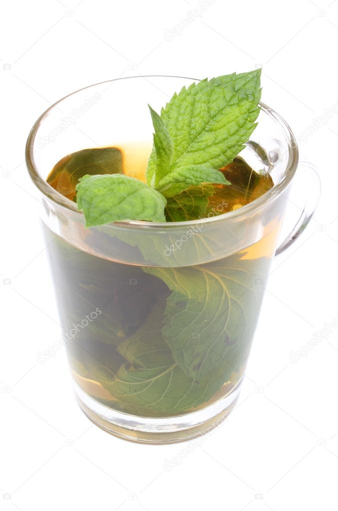 Fresh green mint in cup of beverage. White background