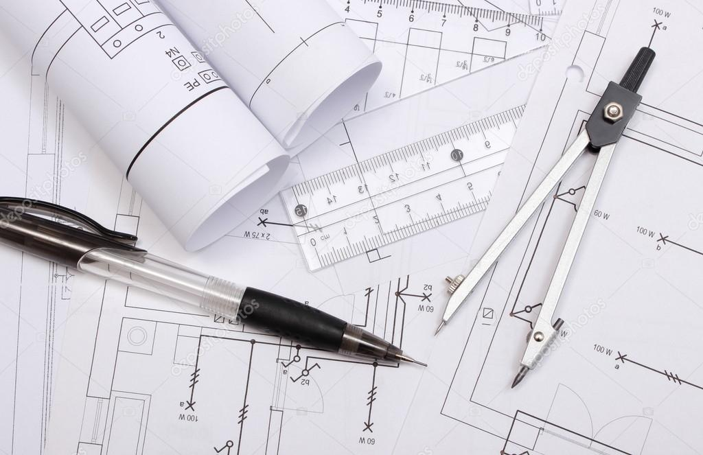 Rolou diagramas eltricos e acessrios para desenho stock photo rolled electrical diagrams and accessories for drawing lying on construction drawing of house drawings and accessories for the projects engineer jobs ccuart Choice Image