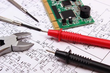 Printed circuit board, precision tools and cable of multimeter on diagram of electronics