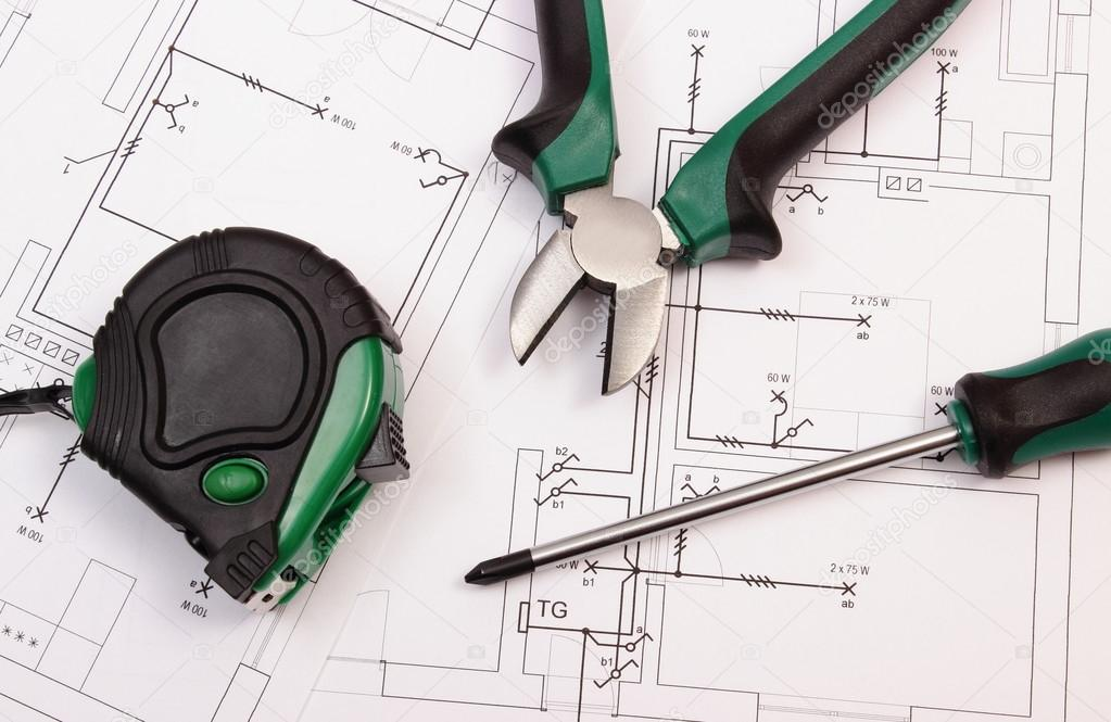 work tools on electrical construction drawing of house stock po
