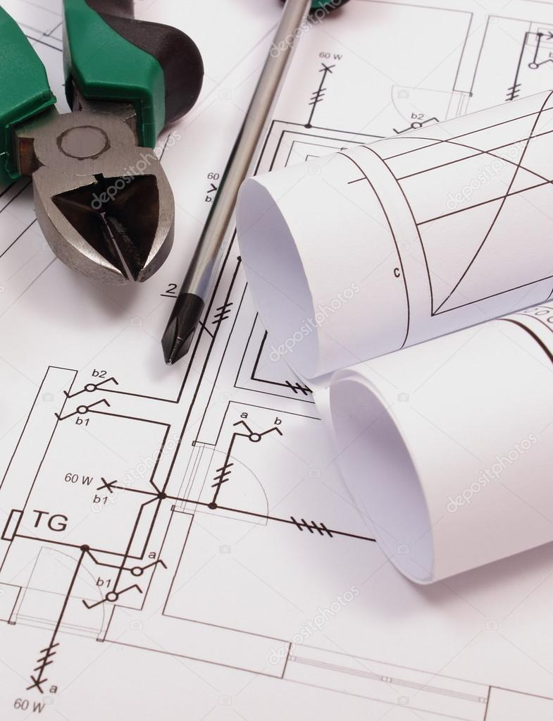 Rolls of diagrams and work tools on electrical construction drawing ...