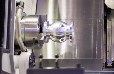 operator turning aluminium autopart by cnc lathe