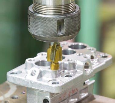 operator machining automotive parts by machining center