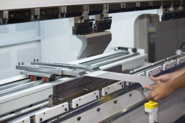 operator bending metal sheet by sheet bending machine