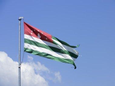 New Athos. Flag of Abkhazia on the background of Simon the Zealot Monastery. Abkhazia