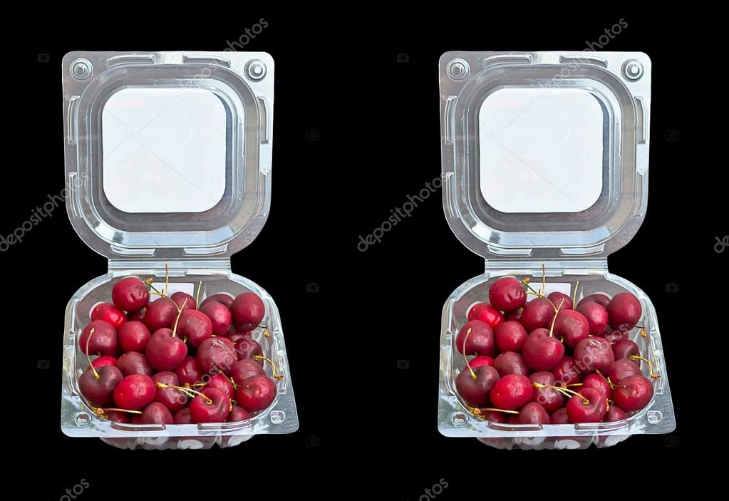 cherry in a plastic box isolated on black background