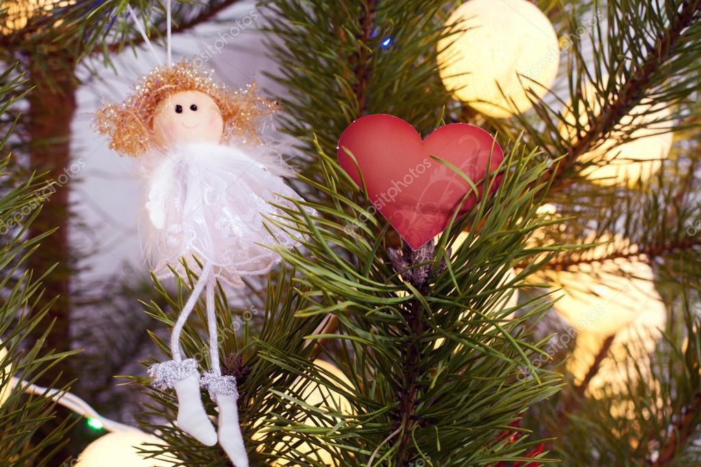 Angel Shaped Christmas Tree.Heart Shaped Card And Angel On Christmas Tree Stock Photo