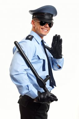 Smiling policeman greets you