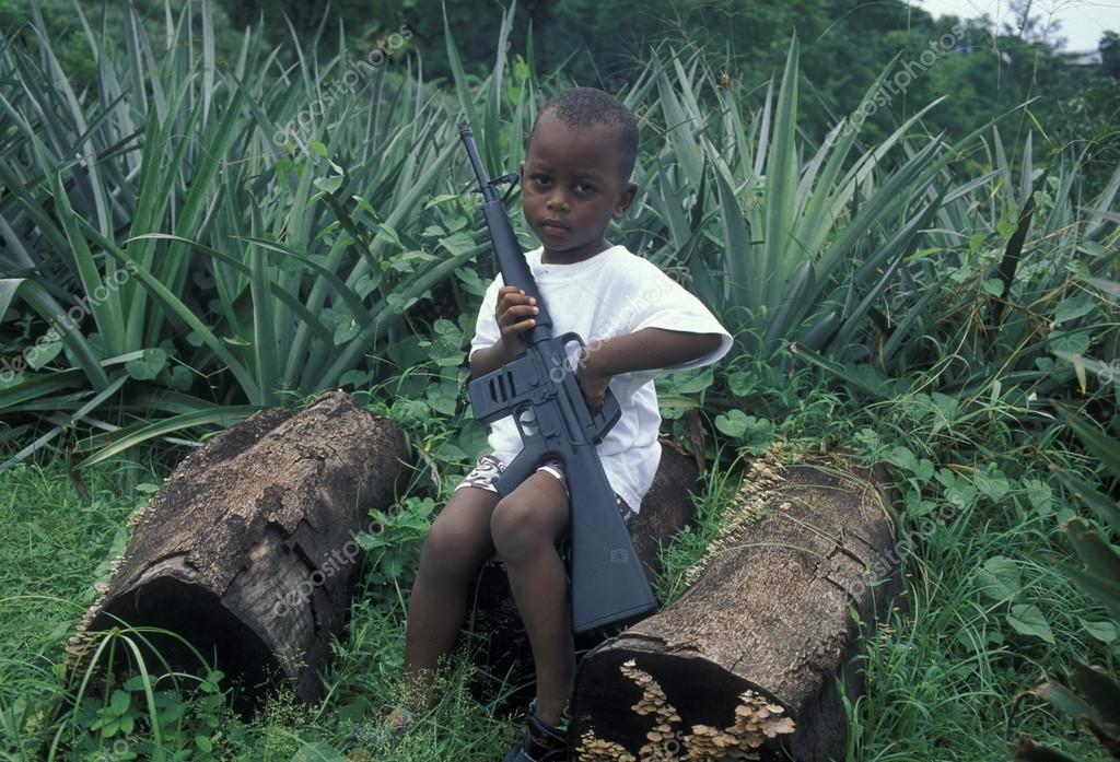 little african boy with automatic rifle