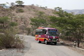 Bus on road near village of Moubisse