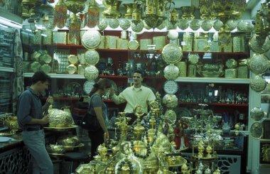 vendor at counter of souvenir shop
