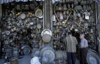 vendor showing traditional brass souvenirs